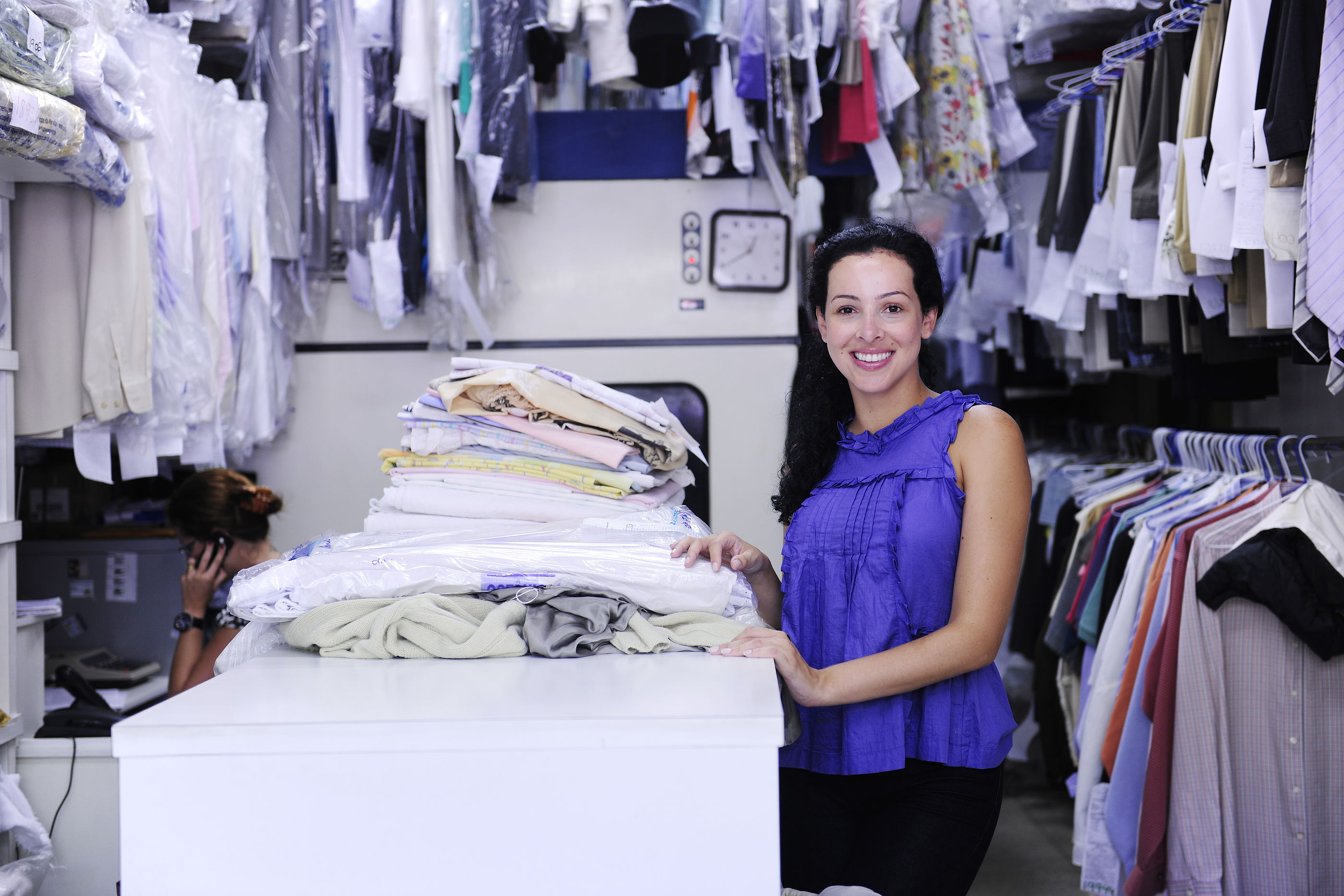 Image of Dry Cleaner Laundry with employee
